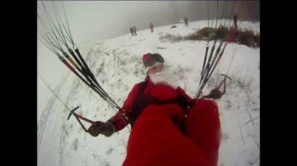Santa Claus and the paraglider.